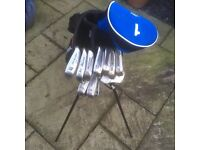 Full sets of golf clubs and bag