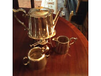 This is an unusual antique c.1870-1880 spirit Tea Pot on stand with matching items.