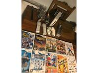 Wii console, 2 controllers, 2 nunchucks and 10 games