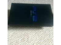 PlayStation 2 with controller/game.