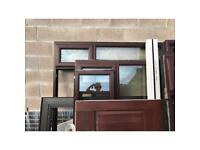 Brown UPVC windows and a wooden front door
