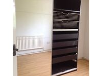 Large glass fronted wardrobe.
