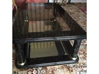 Two shelf glass coffee table for sale