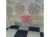 ROMAN BLIND IN PINK GREY AND GREEN STARBURSTS