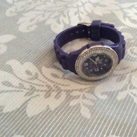 purple ice watch plastic still on never worn