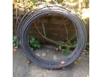 LARGE REEL OF GALVANIZED WIRE.
