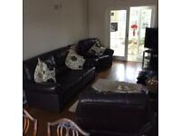 3 seater leather brown sofa and 2 chairs 1 has rip