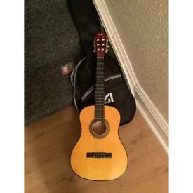 Guitar, case, spare strings,and picks