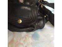 Well loved genuine black Mulberry handbag