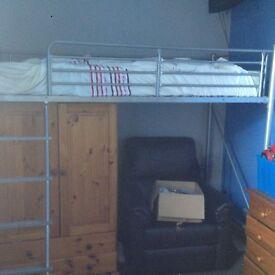 High metal frame bed.