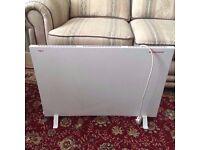 Winterwarm freestanding or wall mounted electric slim radiator heater panel.