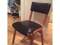 Wooden chair with faux leather cushions - would be a great upcycle project!