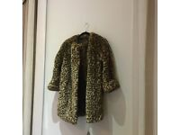 Nearly new faux fur 3/4 coat