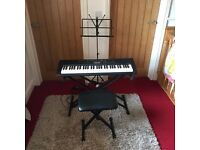 Casio CTK 110 electric keyboard with stool