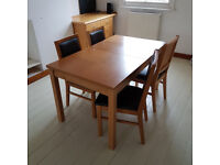 Dining table set: extending, solid oak wooden table and 4 leather-cushioned chairs (Belsize Park)