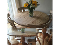 Round pedestal pine table and 4 chairs