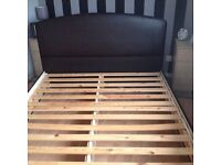 Dark brown leather look king size bed frame