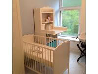 A 3 peice nursery set .. A cot baby dresser unit and wardrobe!! Immaculate !!