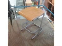 Wooden stool with grey metal legs