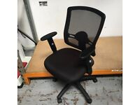 Black mesh backed operator chair