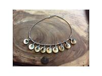 Solid silver and operculum shell necklace