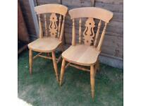 Pair of solid pine fiddle back chairs