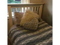 Cream wooden single bed by Julian bowen