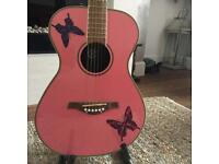 Daisy Rock pink acoustic guitar