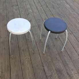 Two Ikea stools and one wooden height adjustable stool