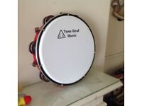 Tone deaf tambourine