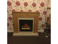 Electric fire and chuncky oak surround