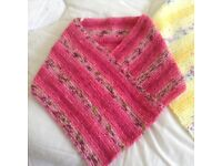 Hand knitted poncho's