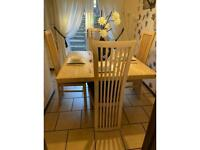 Cream marble dinning table with 4 chairs