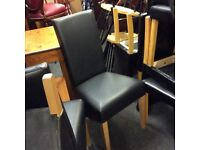 Set of 4 haigh back faux leather chairs