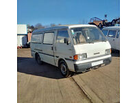 Left hand drive Mazda E2200 long wheel base mini bus.