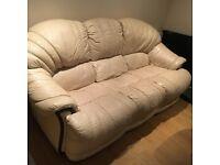 Cream colour 3 seat sofa .