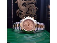 Two tone rolex Daytona with gold face comes complete with bag box and papers