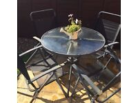 Black metal garden table and 4 chairs