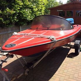 14 foot red Fletcher speed boat with trailer