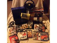 PS2 consol, steering wheel and pedals + a variety of 13 games.
