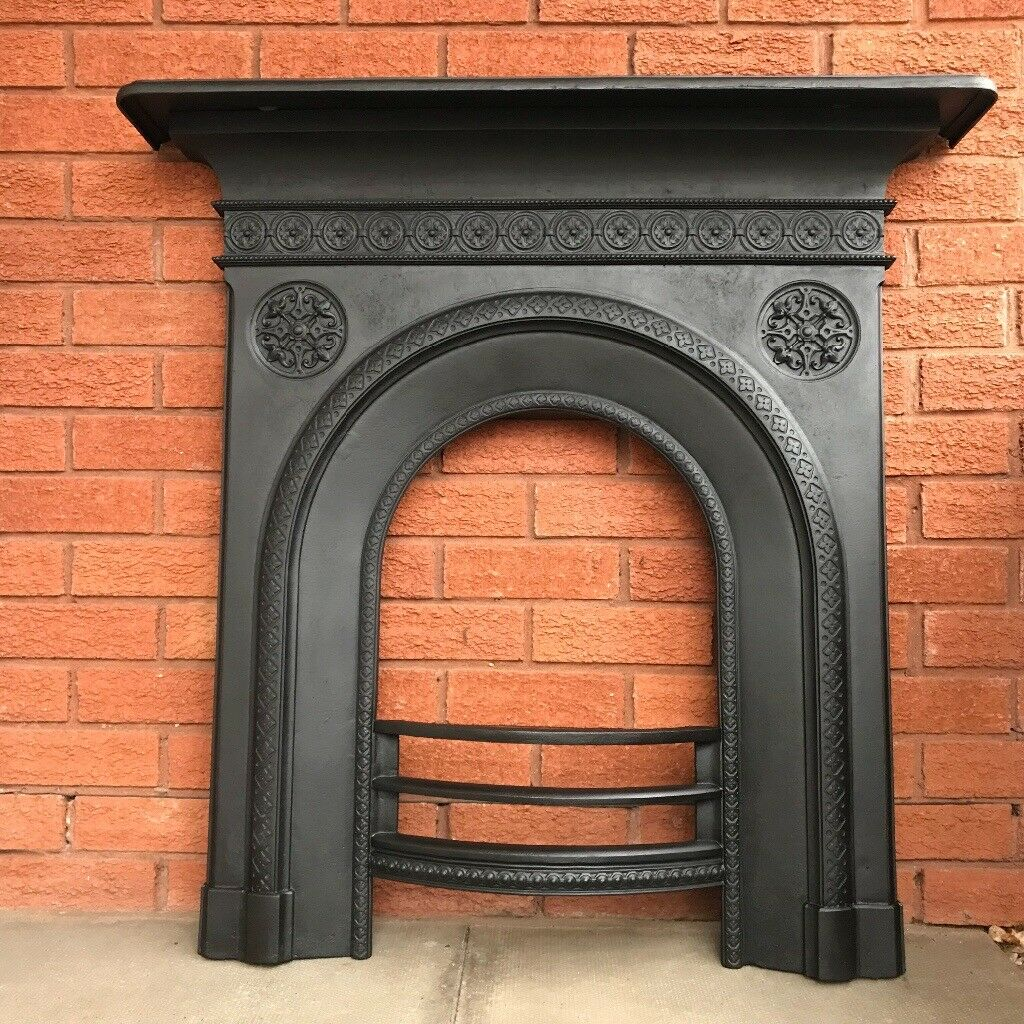 Here we have a stunning Antique Cast Iron Fireplace front complete with mantle.This fireplace has b