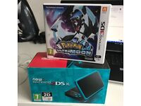 Nintendo 2DS XL Black and Turquoise with Pokemon Ultra Moon