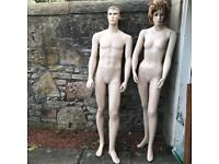 Pair of male and female full size adjustable shop display mannequins