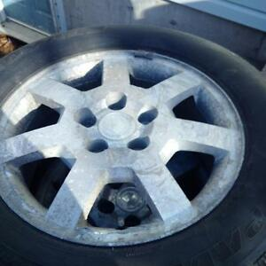 4 winter studded tires for a Cadillac on rims