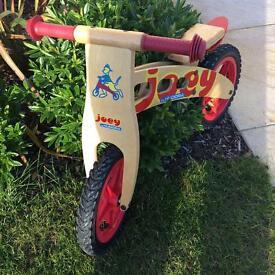 Joey Wooden child's Balance bike