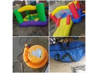 2x kids bouncy castles and pump.