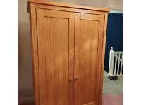 Solid wood double wardrobe with drawer in bottom.