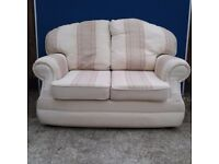 Cream and beige two seater sofa