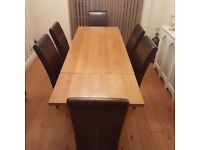 Solid oak dining table and 6 leather chairs