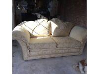 Three seater winged back sofa